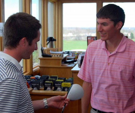Summer Jobs: Ian Suszko and Logan May, left, discuss clubs in the Katke Pro Shop. Right, FSU student Ashley Schultz helps a customer at her job at B-Tan. There are many jobs available for students staying in Big Rapids over the Summer.  Photo By: Sam Lehnert   Ad Layout Assistant
