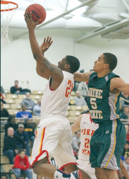 Laying it In: Ferris State senior forward Daniel Sutherlin attempts a shot against Wayne State. The Bulldogs thrilled the crowd with a double overtime victory over the undefeated in conference play Warriors. Photo By: Brock Copus | Multimedia Editor