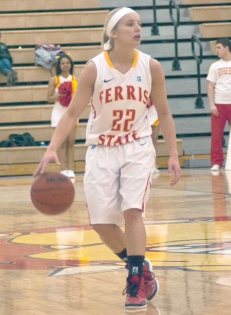 Playmaker: Ferris State junior guard Sarah DeShone dribbles the ball and calls a play to her teammates. The Bulldogs would be unable to make up the ground that Grand Valley State gained early on and would fall at home 83-73. Photo By: Tori Thomas | Photographer