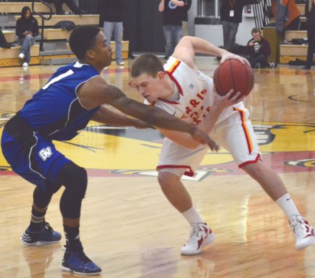 Holding it Back: Ferris State guard Drew Lehman protects the ball from a Grand Valley State defender. The Bulldogs would take a win and a loss on the weekend trip to the Upper Peninsula. Photo By: Eric Trandel | Photographer