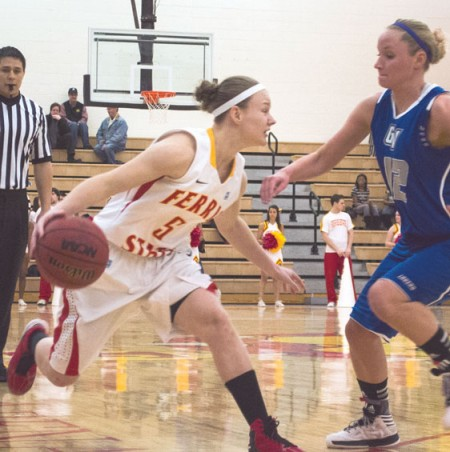 Maintaining Control: Lady Bulldog sophomore guard Morgan Sutton dribbles around a Grand Valley State defender. Ferris State would come out on top over Northern Michigan on the road 73-70. Photo By: Eric Trandel | Photographer