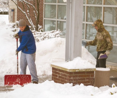 Cleaning Up: Ferris student employees work to clean off sidewalks and salt them after a snowstorm. Photos By: Eric Trandel   Photographer