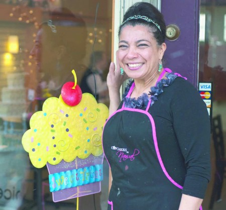 Delicious Treats: Founder Nawal Braden-Swart poses at the storefront of Nawal's Mediterranean Eatery. The locale offers daily lunch and dinner options as well as cupcakes and other treats. Photo By: Tori Thomas| Photographer