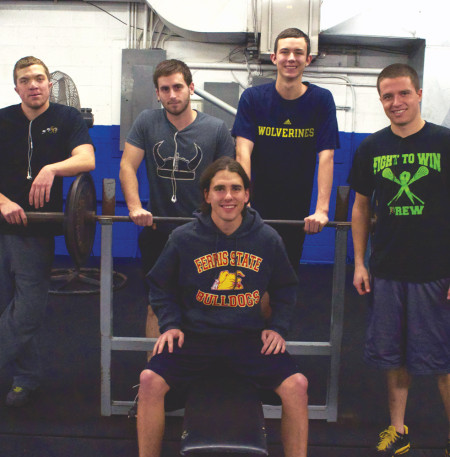 (From left) Jacob Hamlin, Brandon Aube, Tyler Hanson and Anthony Kupser surround their friend Taylor Pike (center) at TNT Gym where he had a heart attack in October. Pike, who isn't back in the gym yet, is thankful for the support of his friends and family during his recovery.  Photo By: Melanie Ronquillo | Photographer