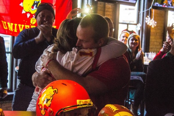 Junior quarterback Jason Vander Laan hugs his mother Cindy